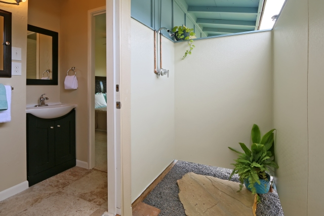 Master bathroom opens up to outdoor shower for tropical living!